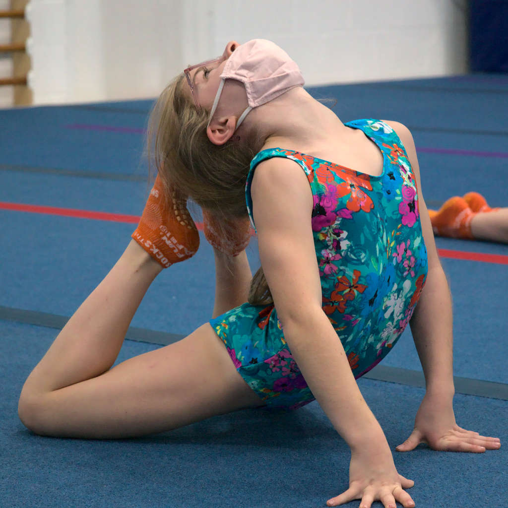 Young gymnast strething on the spring floor at Gymworld gymnastics facility in Northwest London.